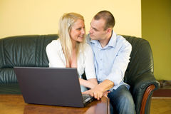 Cute young couple with laptop at home. Stock Photography