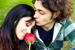 Cute young couple in love with red ros Stock Photo