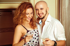 Cute young couple at martini home party Royalty Free Stock Photos