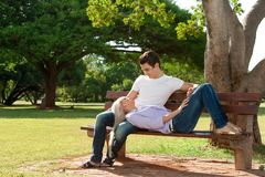 Cute young couple relaxing on bench. Royalty Free Stock Images