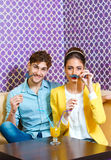 Cute young couple sitting at the table Stock Photography