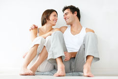 Cute young couple sitting together on the floor Royalty Free Stock Images