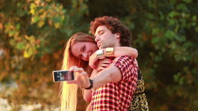 Cute young couple taking selfies and laughing stock video