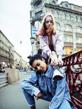 Cute young couple of teenagers girlfriends having fun, traveling europe, modern fashion citylife, lifestyle people Royalty Free Stock Photo