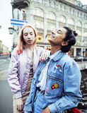 Cute young couple of teenagers girlfriends having fun, traveling europe, modern fashion citylife, lifestyle people. Concept close up stock images