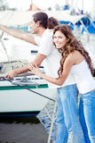Cute young couple waiting at the boat harbour Royalty Free Stock Photo