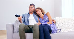 Cute young couple watching TV stock video