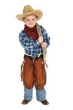 Cute young cowboy stnading smiling holding a rope. Cute young cowboy standing smiling and holding a rope Royalty Free Stock Photos