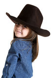 Cute young cowgirl looking over her shoulder smiling Stock Images