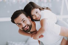 Cute Young Daughter on Piggy Back Ride with Dad. Happy Father`s Day Concept. Father with Daughter Spending Time Togetherness at Home. Happy Family Daughter royalty free stock images