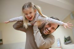 Young dad with cute daughter at home. Stock Photos