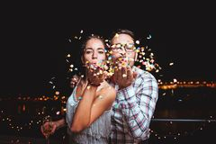 Cute, young, elegant couple having fun, celebrating stock images