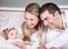 Cute young family at home Stock Image