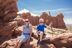 Family hiking together in Arches National Park Royalty Free Stock Photo