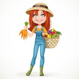 Cute young farmer girl with a big basket of vegetables Royalty Free Stock Images