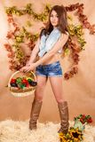 Cute young farmer girl holding the basket of vegetables Royalty Free Stock Image