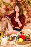 Cute young farmer girl sitting in a hay with a harvest Stock Photography