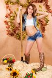 Cute young farmer girl working with the pitchfork in a haystack Royalty Free Stock Photos