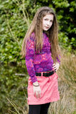 Cute young fashion girl in park Royalty Free Stock Photography