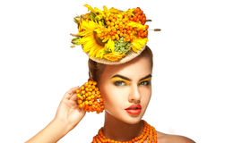 Cute young fashion model with rowanberry on head Royalty Free Stock Photos