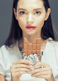 Cute young female with chocolate close up eating Royalty Free Stock Photo