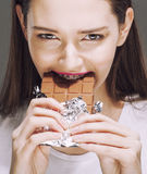 Cute young female with chocolate close up eating Stock Photo