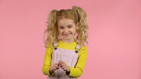 Cute young female is drawing heart and smiling stock footage