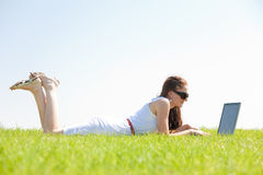 A cute young female lying on the grass Stock Photography