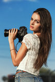 Cute young female photographer with camera outdoors Royalty Free Stock Photography