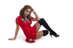 Cute young female in red racing dress Royalty Free Stock Images