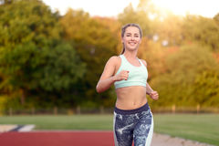 Cute young female runner in tank top Stock Photography