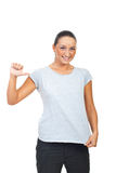 Cute young female showing t-shirt Stock Images