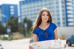 Cute young female traveler with a map of the city Stock Image