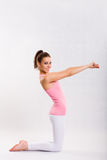 Cute young fitnes girl doing exercises. royalty free stock photos