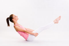 Cute young fitnes girl doing exercises. Royalty Free Stock Image