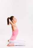 Cute young fitnes girl doing exercises. Stock Images