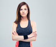 Cute young fitness woman with arms folded Royalty Free Stock Photo
