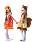 Cute young friends posing in carnival costumes Stock Photos