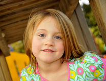 Cute Young Girl. Posing and Smiling for the Camera Royalty Free Stock Photos