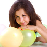Cute young girl with balloons
