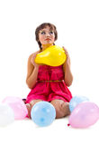 Cute young girl with balloons Royalty Free Stock Photography
