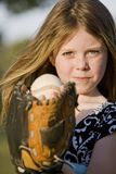 Cute young girl with a baseball Stock Photos