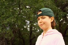 Cute young girl with baseball cap Royalty Free Stock Images