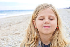 Cute young girl at the beach Stock Photo