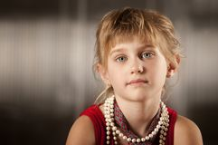 Cute young girl with big eyes stock image