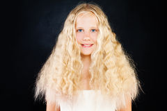 Cute Young Girl with Blonde Curly Hair. Blonde Teen Girl. With Curly Hair on Dark Background Stock Image