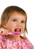 Cute young girl brushing her teeth Royalty Free Stock Image
