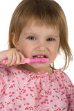 Cute young girl brushing her teeth Stock Photography