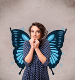 Young girl with butterfly blue illustration on the back. Cute young girl with butterfly blue illustration on the back royalty free stock photo