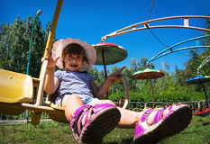 Child dizzy on amusement in the Park Stock Image